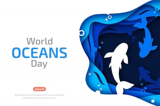 世界海洋デー。海の波と魚のペーパーアート