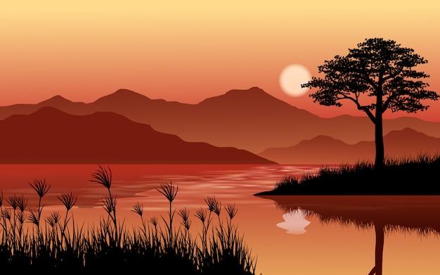 川と丘の屋外の日没の風景