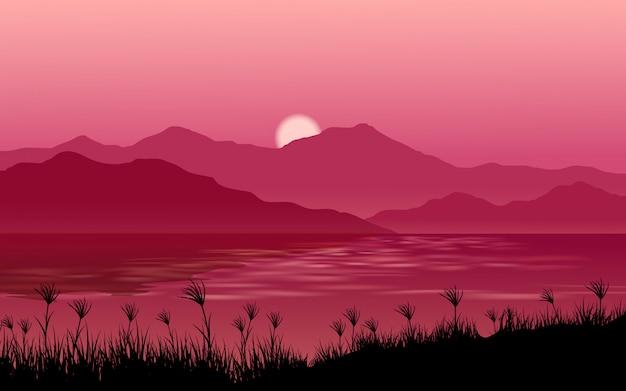 川と丘の日没の風景