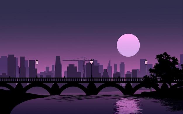 Полная луна над городом с рекой и мостом