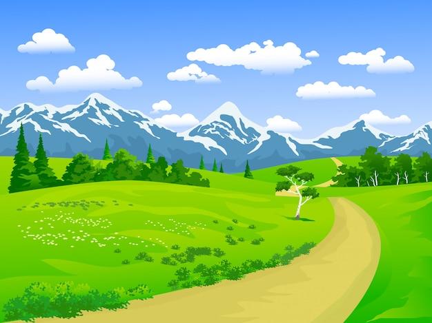 雪に覆われた山と牧草地の自然風景