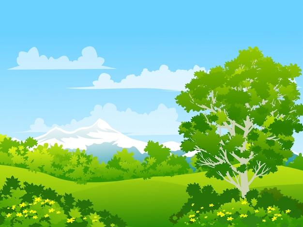 花の咲く緑の牧草地と雪に覆われた山の田園地帯の自然風景