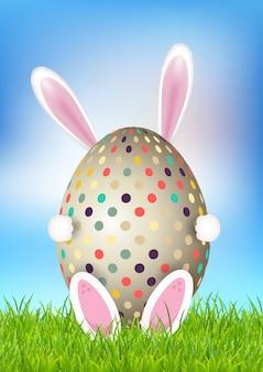 卵を保持しているバニーとかわいいイースターの背景