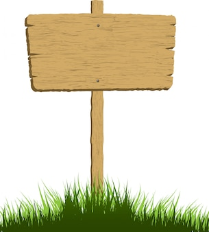 草の中の木の看板
