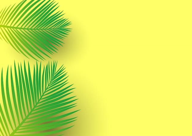 明るい黄色の背景にヤシの木の葉