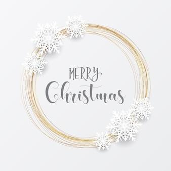金の円形フレームと雪の結晶のエレガントなクリスマス