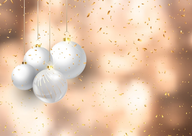 Рождественские шары на фоне конфетти