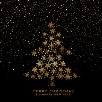 雪の黄金のクリスマスツリー