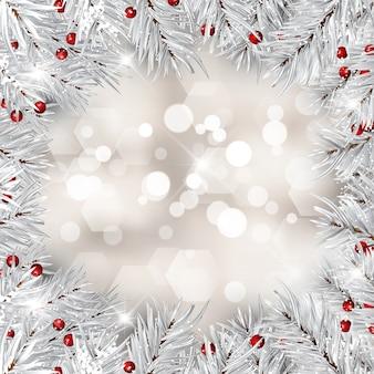 銀のクリスマスツリーの枝と赤い果実
