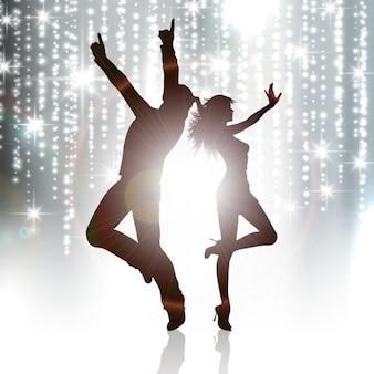 カップルダンスのシルエットの背景