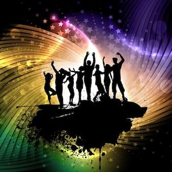 踊る人々のシルエットとグランジスタイルの背景