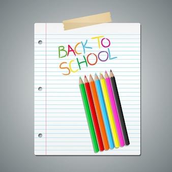 並んで紙の上に色とりどりの鉛筆
