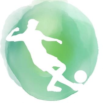 水彩画の背景にサッカー選手のシルエット