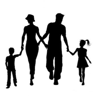家族の歩行のシルエット
