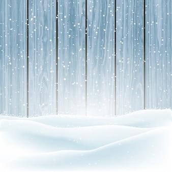 木製の背景にクリスマスの冬の雪