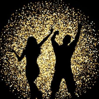 Силуэты пара танцует на фоне золотого блеска