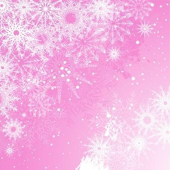 雪に覆われたピンクのクリスマスの背景