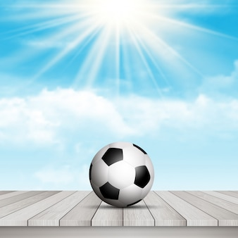 Футбольный мяч на стол против голубого неба