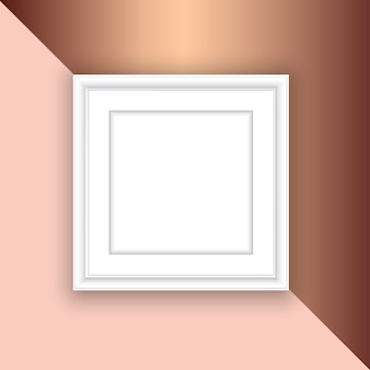 ローズゴールドの背景に空白の白い額縁