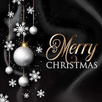Рождественские блесна и снежинки на черной мраморной текстуре
