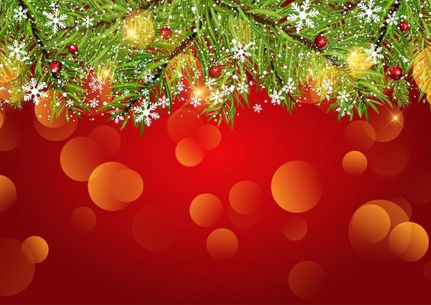 クリスマスの背景に雪片とボケの光