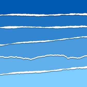 青いベクトル破れた紙の背景