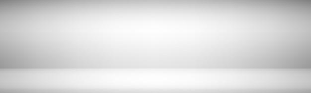 明るい灰色の広いグラデーションモダンなスタジオショーケースの背景
