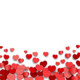 バレンタインデーの背景にハートのステッカーが散在