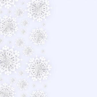 白い雪片とクリスマスの背景
