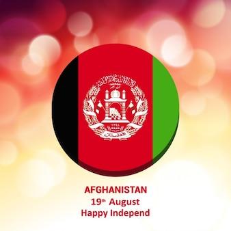 輝く背景アフガニスタンの旗ボタン