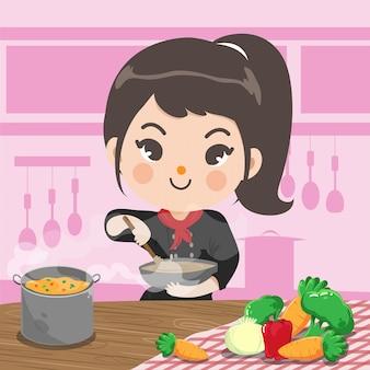 シェフの女の子は彼女の台所で幸せな愛を込めて料理をしています。