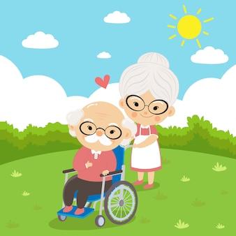 祖母は世話をします祖父は病気のときに愛情と心配を持って車椅子に座っています。