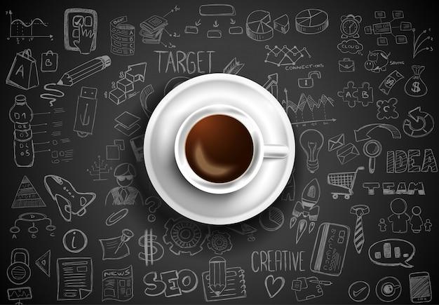 インフォグラフィックスケッチとテーブルの上のコーヒーのトップビュー
