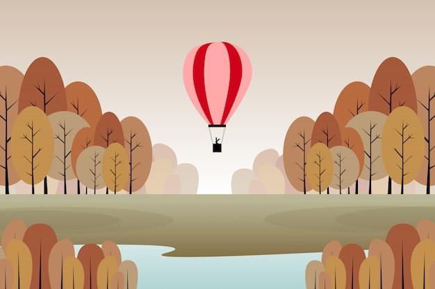 赤い風船のイラストと秋の森の風景