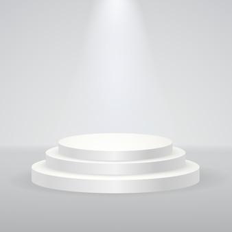 グレー色のスタジオとスポットライトのシーンと白い円形の表彰台台座