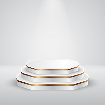 グレーカラースタジオのスポットライトシーンが付いている白および金の円形の表彰台台座