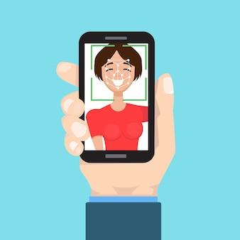 Биометрическая идентификация, концепция системы распознавания лиц. смартфон в руке.