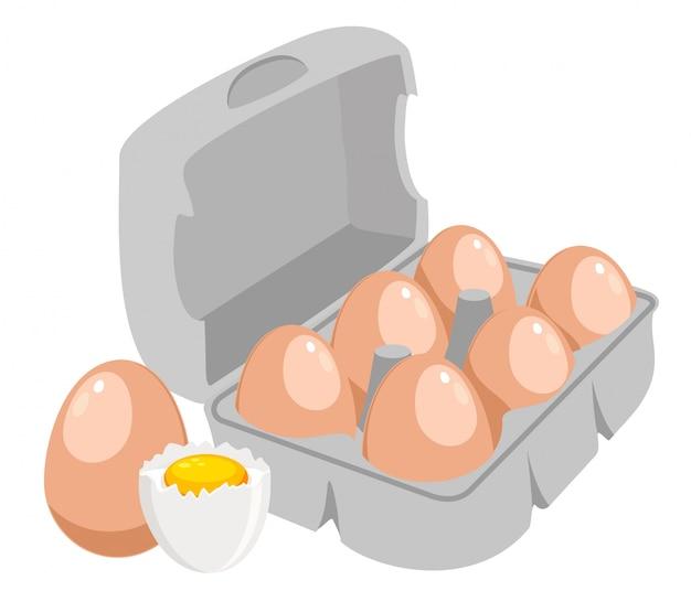 鶏の卵。紙箱の図に茶色の卵。半殻の新鮮な液体卵。