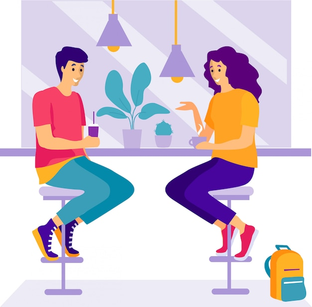 Две женщины сидят в кафе и разговаривают.