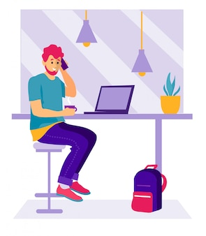 ラップトップ付きのカフェの男。コーヒーを飲みながら、カフェに座って仕事で若い男