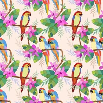 花と枝にコンゴウインコのシームレスパターン