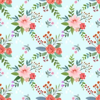 手は、織物の壁紙のカラフルな花のシームレスなパターンを描画します。