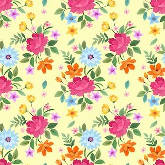 黄色の背景パターンベクトルデザインにカラフルな花