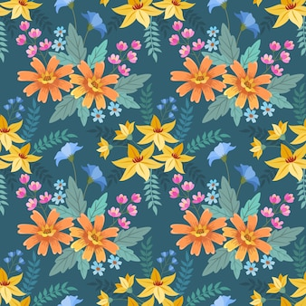 青色の背景に色とりどりの花とのシームレスなパターン。