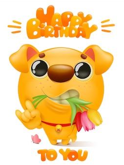 グリーティングカードにお誕生日おめでとう。歯と花を保持している漫画の黄色い犬キャラクター