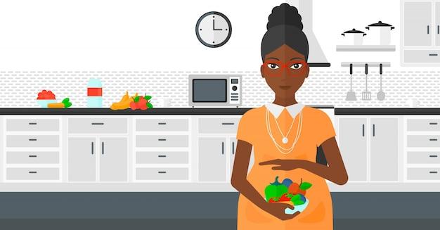 野菜と妊娠中の女性。