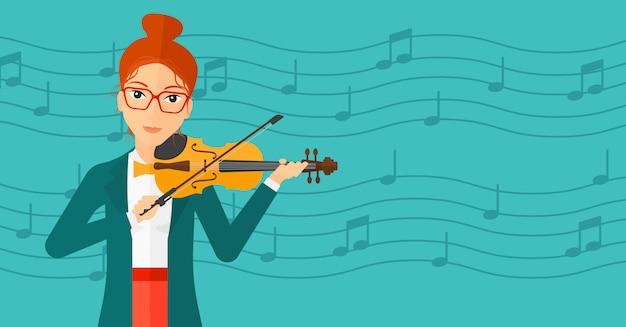 バイオリンを弾く女性。