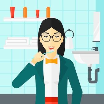 女性の歯を磨きます。