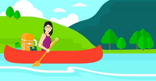 Женщина на каноэ по реке.