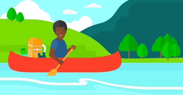 Мужчина каноэ по реке.